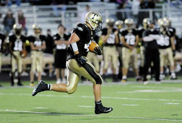 Running back Don Cherry, # 44 of Trumbull breaks a long run during high school football game between Greenwich High School and Trumbull High School at Trumbull High School, Thursday night, Oct. 6, 2011. Photo: Bob Luckey / Greenwich Time