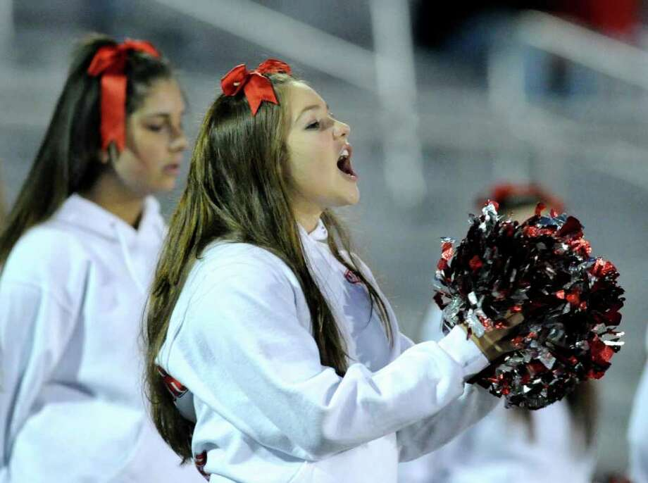 A GHS cheerleader in action during high school football game between Greenwich High School and Trumbull High School at Trumbull High School, Thursday night, Oct. 6, 2011. Photo: Bob Luckey / Greenwich Time