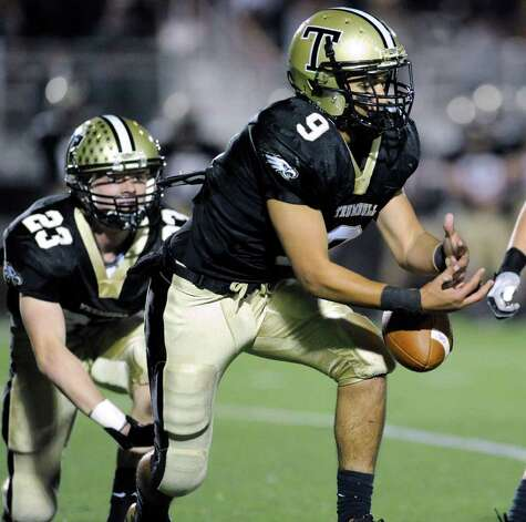 Matt Nakano, # 9 of Trumbull High School, can not hold onto the ball on an interception attempt during high school football game between Greenwich High School and Trumbull High School at Trumbull High School, Thursday night, Oct. 6, 2011.  At left is Michael Uus, # 23, of Trumbull. Photo: Bob Luckey / Greenwich Time