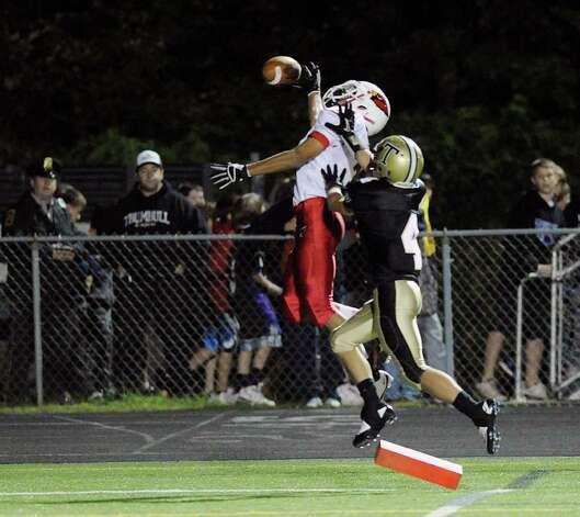 At left, Joel Arroyo, # 3, of Greenwich, misses on a pass reception while being covered by Jeff Jarboe of Trumbull during high school football game between Greenwich High School and Trumbull High School at Trumbull High School, Thursday night, Oct. 6, 2011. Photo: Bob Luckey / Greenwich Time