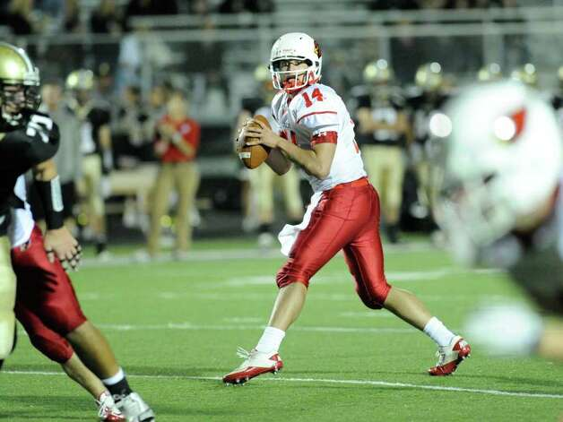 QB Liam O'Neil, # 14 of Greenwich High School in action during High school football game between Greenwich High School and Trumbull High School at Trumbull High School, Thursday night, Oct. 6, 2011. Photo: Bob Luckey / Greenwich Time