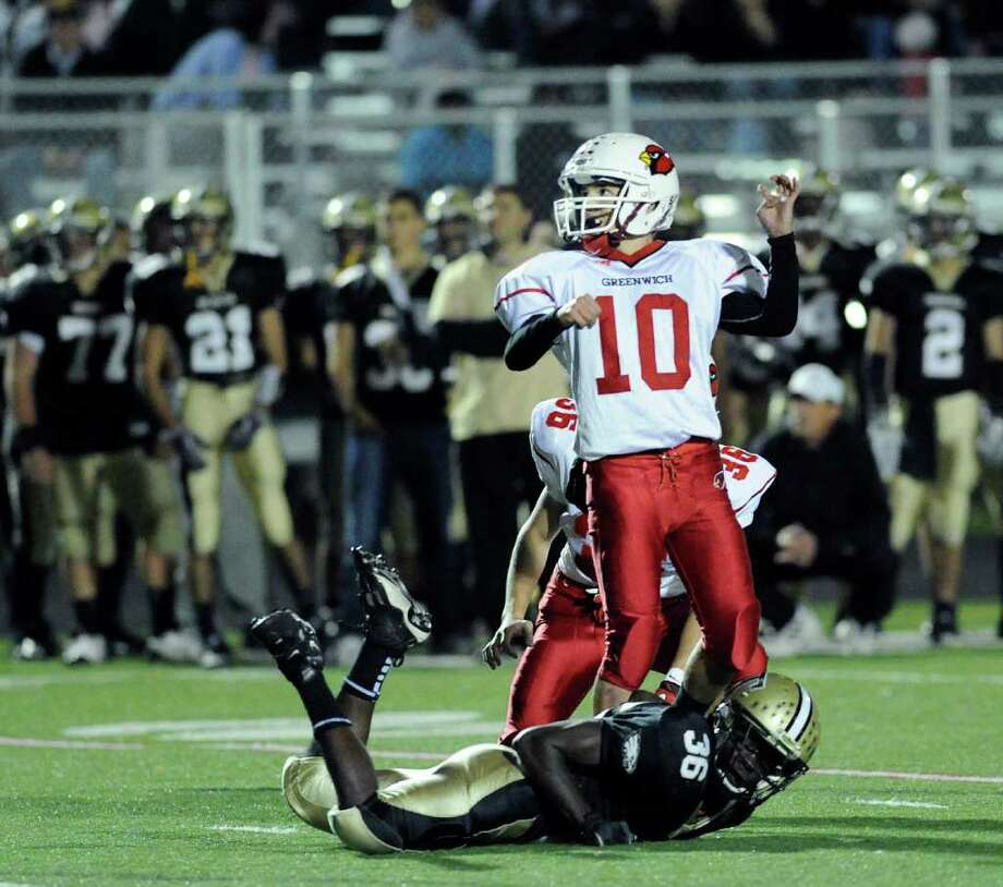 Jesse Adelberg, # 10 of Greenwich High School, connects on a field goal during High school football game between Greenwich High School and Trumbull High School at Trumbull High School, Thursday night, Oct. 6, 2011. On the ground after missing the block is Seon Ramsay, # 36 of Trumbull. Photo: Bob Luckey / Greenwich Time