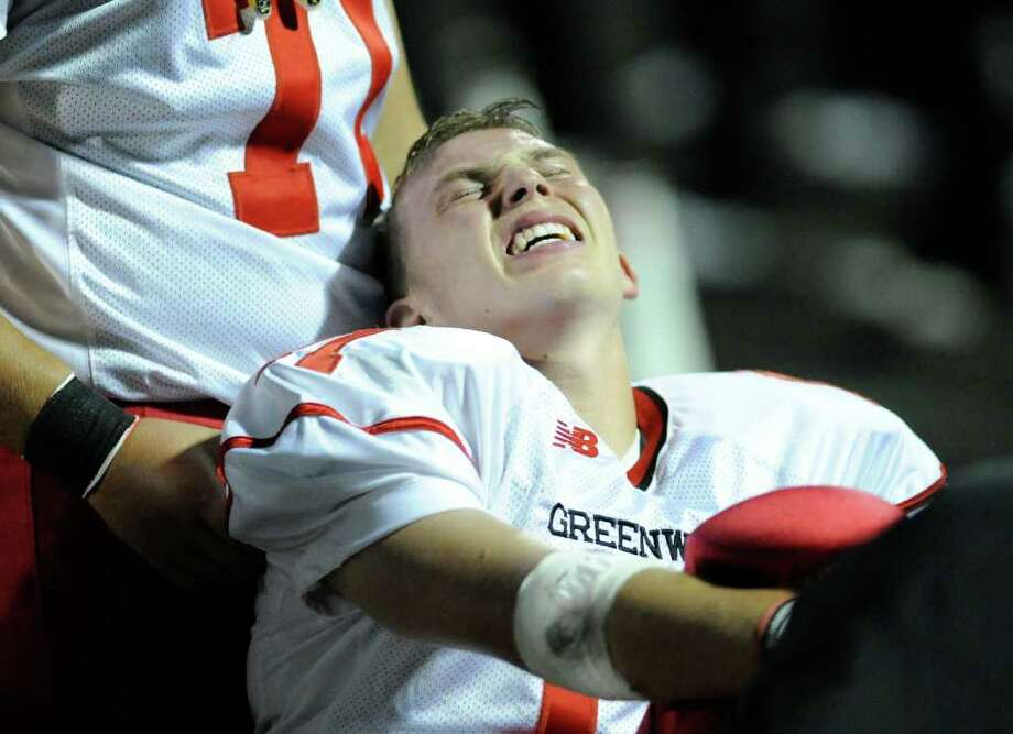 Alex McMurray of Greenwich High School grimaces on the sideline during High school football game between Greenwich High School and Trumbull High School at Trumbull High School, Thursday night, Oct. 6, 2011. Photo: Bob Luckey / Greenwich Time