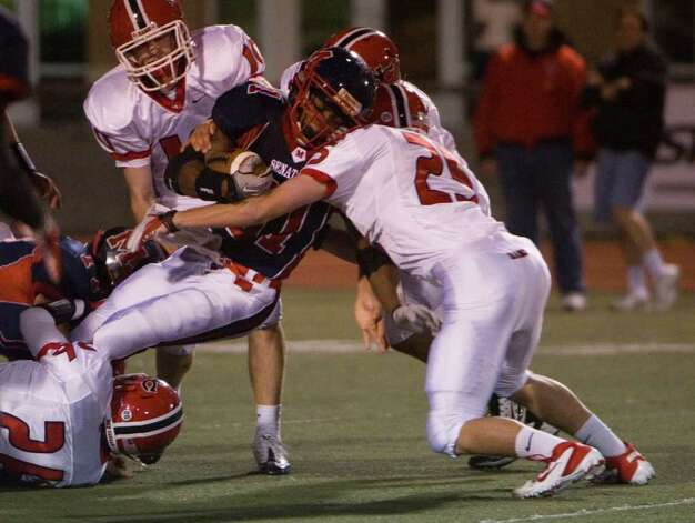 McMahon's Kyle Jordan pushes for yards as Brien McMahon hosts New Canaan High School in a football game October 6, 2011. Photo: Keelin Daly / Stamford Advocate