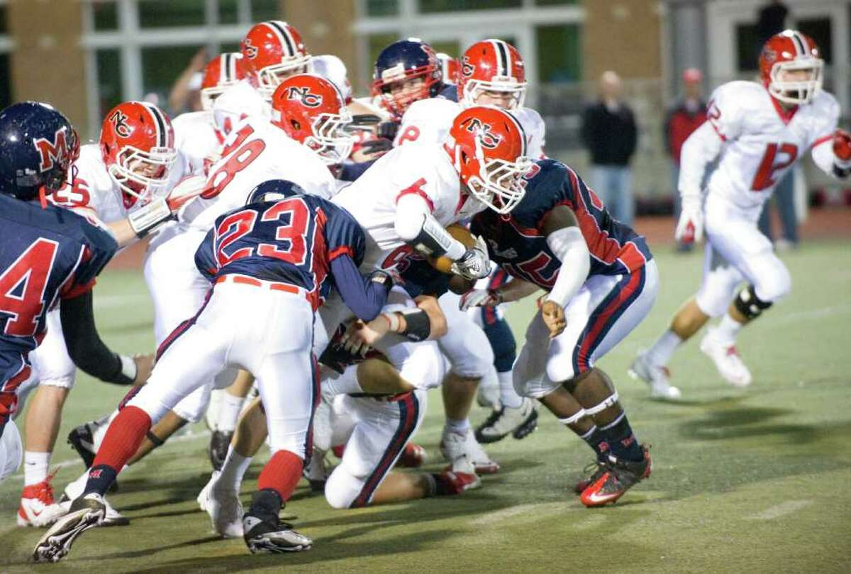 New Canaan's Teddy Bossidy in action as Brien McMahon hosts New Canaan High School in a football game October 6, 2011.