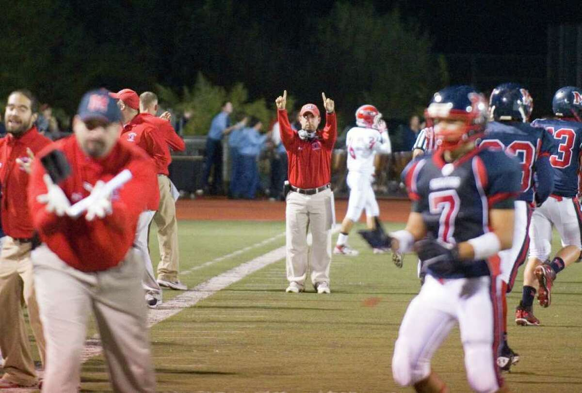 McMahon Coach AJ Albano reacts to a touchdown as Brien McMahon hosts New Canaan High School in a football game October 6, 2011.