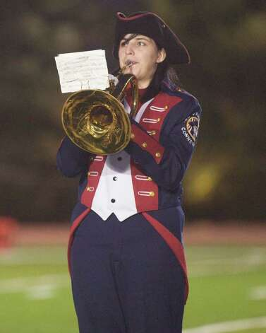A Rebels' band member performs before New Fairfield High School's football game against Brookfield high School Friday night, Oct. 6, 2011 at New Fairfield High School. Photo: Barry Horn
