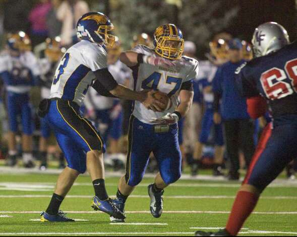Brookfield High School's Tyler Pulisi scored a touchdown after taking a handoff from quarterback Boeing Brown during the Bobcats' SWC football game against New Fairfield High School, Friday night, Oct. 6, 2011, at New Fairfield High School. Photo: Barry Horn / The News-Times Freelance