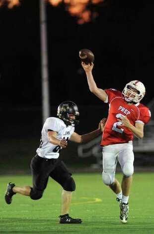 Fairfield Prep's Thomas Brewster passes the ball as Jonathan Law's Ian Malone defends during their game Thursday Oct. 6, 2011 at Alumni Field at Fairfield University. Photo: Autumn Driscoll