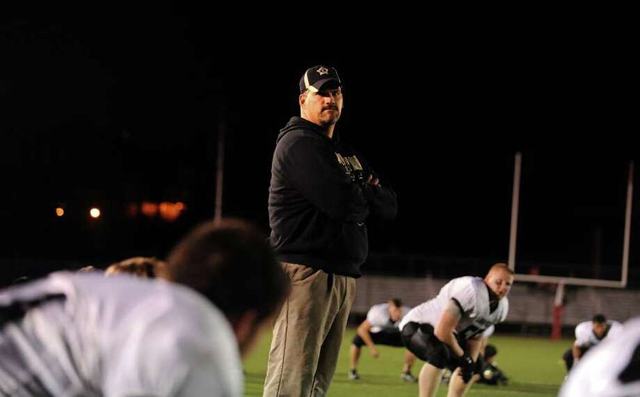 Jonathan Law football coach Mark Robinson during their game against Fairfield Prep Thursday Oct. 6, 2011 at Alumni Field at Fairfield University. Photo: Autumn Driscoll