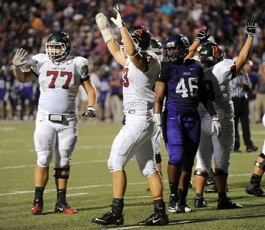 The Woodlands celebrates after scoring a touchdown against Lufkin in Thursday night's game. (Joel Andrews/Lufkin News)