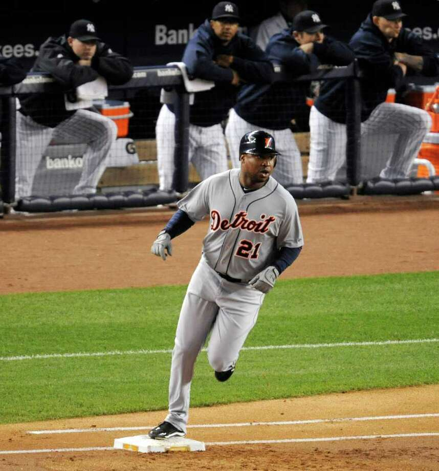 Detroit Tigers' Delmon Young rounds first base after hitting a home run off New York Yankees pitcher Ivan Nova in the first inning during Game 5 of baseball's American League division series Thursday, Oct. 6, 2011, at Yankee Stadium in New York. (AP Photo/Bill Kostroun) Photo: Bill Kostroun