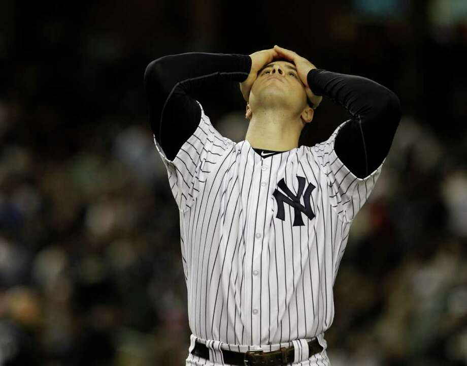 New York Yankees' Mark Teixeira reacts after temmate Nick Swisher struck out with bases loaded in the seventh inning in Game 5 of baseball's American League division series agisnt the detroit Tigers Thursday, Oct. 6, 2011  in New York.  (AP Photo/Kathy Willens) Photo: Kathy Willens