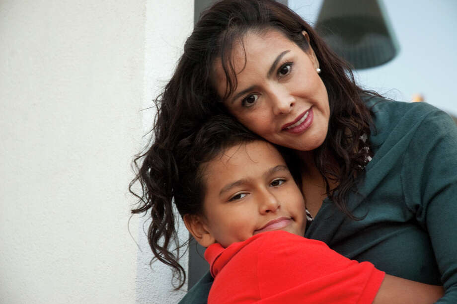 Berenice Diaz and her son Jean Paul Lacombe were reunited last year after his father took him to France. Photo: Ruben Castro Arans/Special To The Express-News / SAN ANTONIO EXPRESS-NEWS