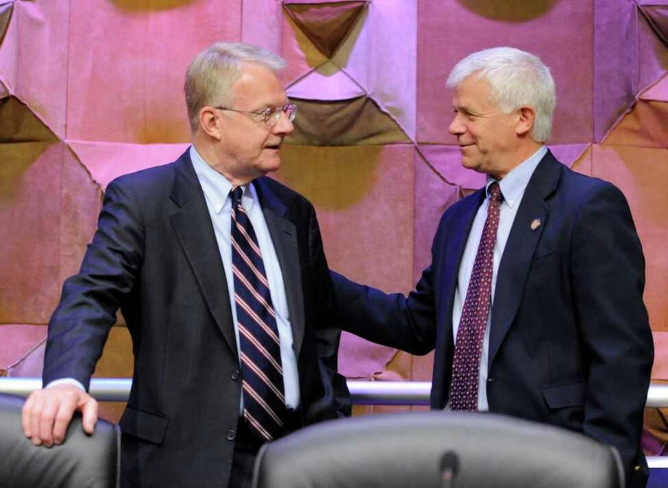 ENCON Commissioner Joe Martens, right speaks with Assemblyman Robert K. Sweeney, left before the start of the hearing on hydro fracking which was chaired by Sweeney in Albany, N.Y. October 6, 2011. (Skip Dickstein / Times Union)