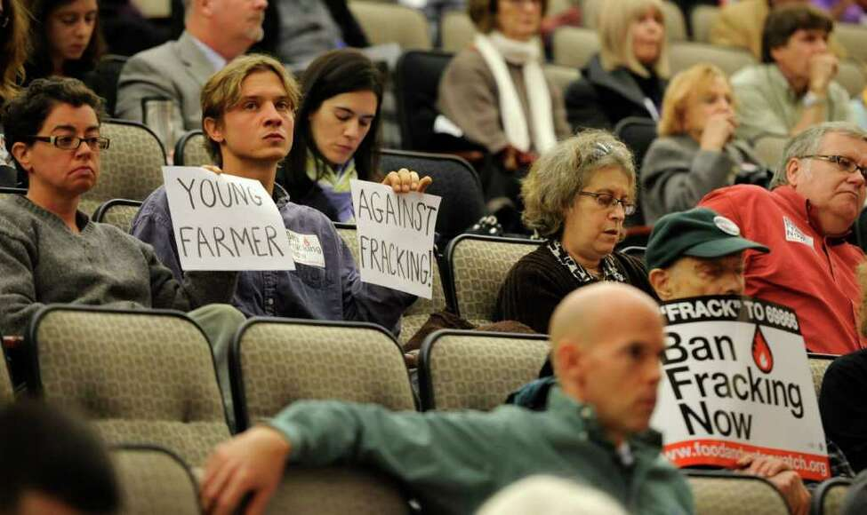 Clemens MacKay of Solstice Hill Farm in Cobleskill sits in silent protest to fracking before the start of a hearing on hydro fracking in Albany, N.Y. October 6, 2011. (Skip Dickstein / Times Union)