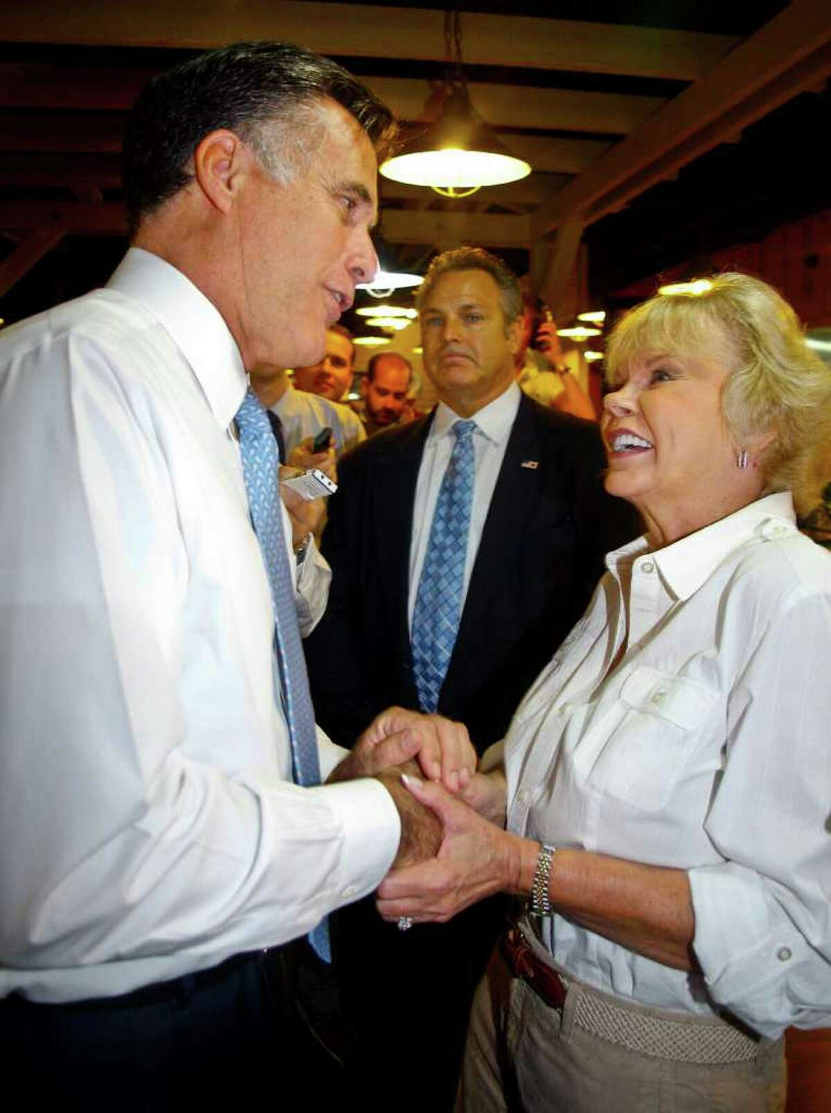 Republican presidential candidate former Massachusetts Gov. Mitt Romney, left, greets Sylvia Jordan during a lunch stop at Seminole Wind restaurant Wednesday, Oct. 5, 2011, in Tallahassee, Fla. Jordan told Romney to make sure he ate the okra at the restaurant's buffet, a comment based on his local radio interview earlier in the day where he had been asked his position on okra. (AP Photo/Phil Sears)