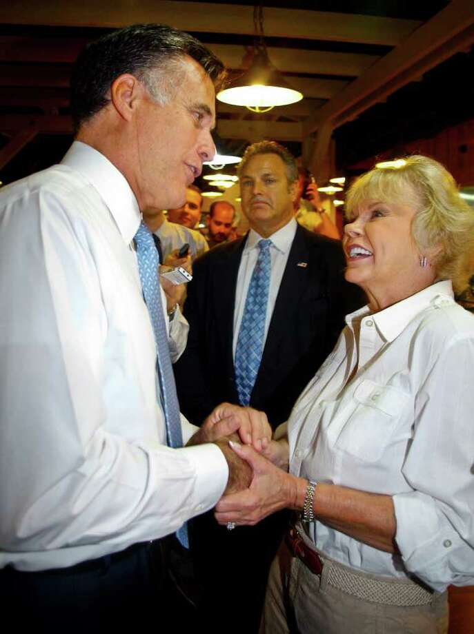 Republican presidential candidate former Massachusetts Gov. Mitt Romney, left, greets Sylvia Jordan during a lunch stop at Seminole Wind restaurant Wednesday, Oct. 5, 2011, in Tallahassee, Fla. Jordan told Romney to make sure he ate the okra at the restaurant's buffet, a comment based on his local radio interview earlier in the day where he had been asked his position on okra. (AP Photo/Phil Sears) Photo: Phil Sears