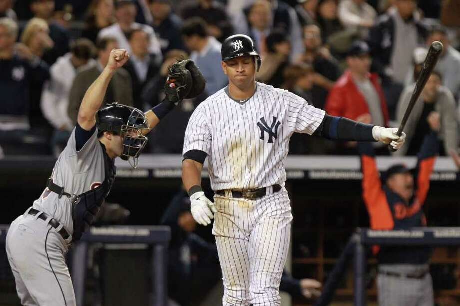 NICK LAHAM: GETTY IMAGES AGONY AND ECSTASY: Tigers catcher Alex Avila, left, is ready to celebrate after Alex Rodriguez fanned against Jose Valverde for the final out at Yankee Stadium this season. Photo: Nick Laham / 2011 Getty Images