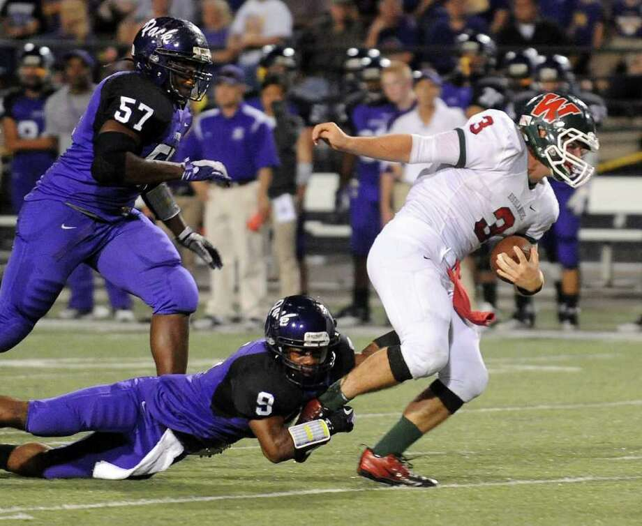 JOEL ANDREWS: LUFKIN NEWS THAT'S A NO-GO: The Woodlands' Lance Miles, right, can't quite get a leg up on determined Lufkin defender Jomal Davis during Thursday night's District 14-5A battle.