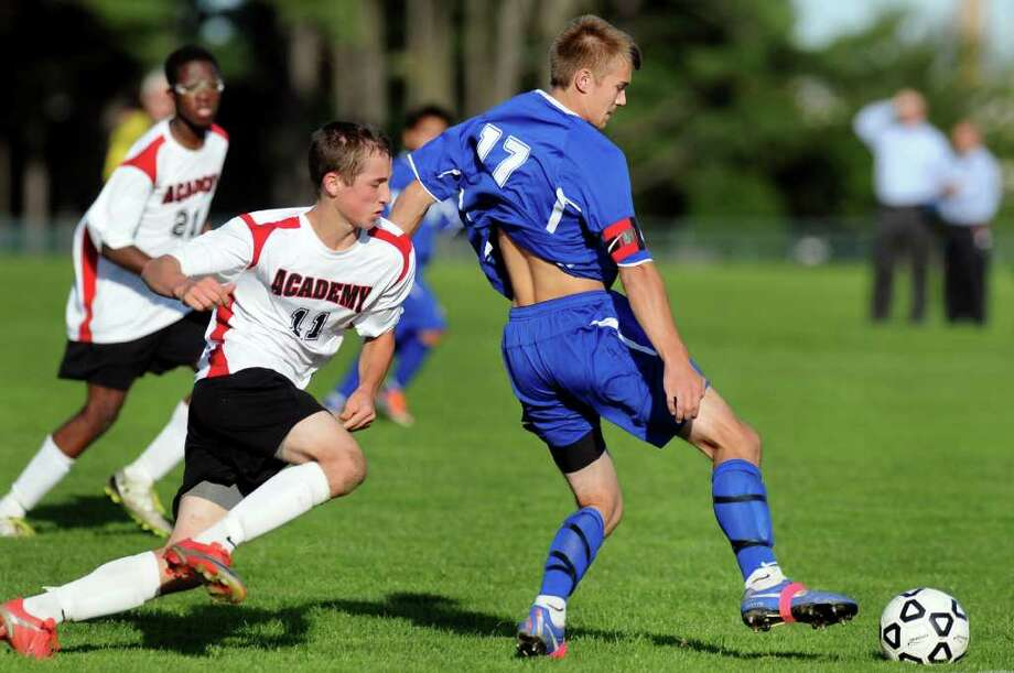 Icabod Crane's Justyn Verbraska (17), right, keeps after the ball as Academy's John Moutopolis (11), left, pursues during their soccer game on Thursday, Oct. 6, 2011, at Albany Academy in Albany, N.Y. (Cindy Schultz / Times Union) Photo: Cindy Schultz