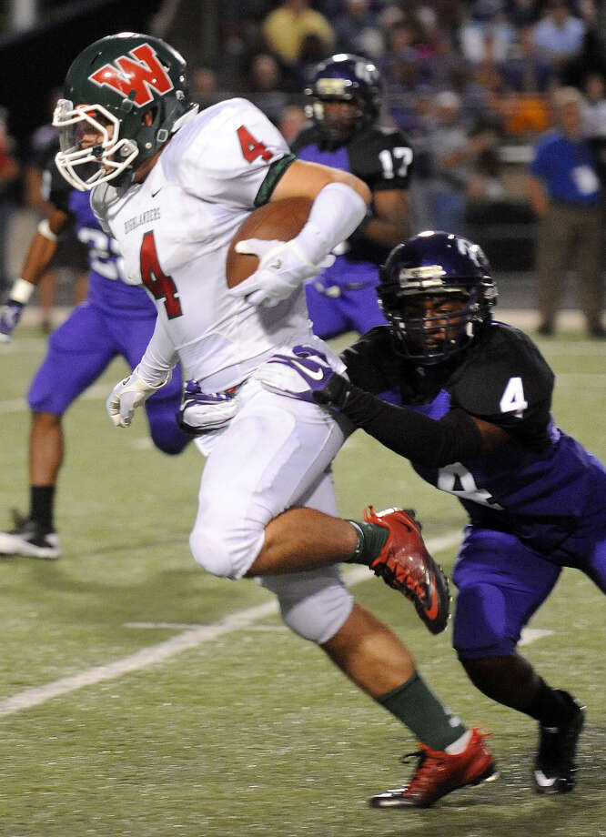 The Woodlands' Christian Jauregui is caught by Lufkin's Christon Ballard. (Joel Andrews/Lufkin News)