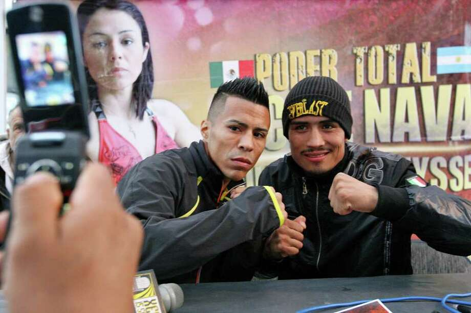 Raul Martinez (left) and Rodrigo Guerrero pose for a photo after an interview Wednesday Oct. 5, 2011 in Tijuana, Baja California, Mexico.  Martinez and Guerrero will fight for the IBF super flyweight title Saturday Oct. 8 in Tijuana.  (PHOTO BY EDWARD A. ORNELAS/eaornelas@express-news.net) Photo: EDWARD A. ORNELAS, SAN ANTONIO EXPRESS-NEWS / © SAN ANTONIO EXPRESS-NEWS (NFS)