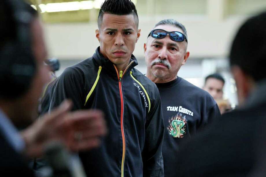 Raul Martinez (left) and cutman Joe Villanueva listen to former boxer Jesus Chavez during an interview Wednesday Oct. 5, 2011 in Tijuana, Baja California, Mexico. Martinez will fight Rodrigo Guerrero (not pictured) for the IBF super flyweight title Saturday Oct. 8 in Tijuana.  (PHOTO BY EDWARD A. ORNELAS/eaornelas@express-news.net) Photo: EDWARD A. ORNELAS, SAN ANTONIO EXPRESS-NEWS / © SAN ANTONIO EXPRESS-NEWS (NFS)
