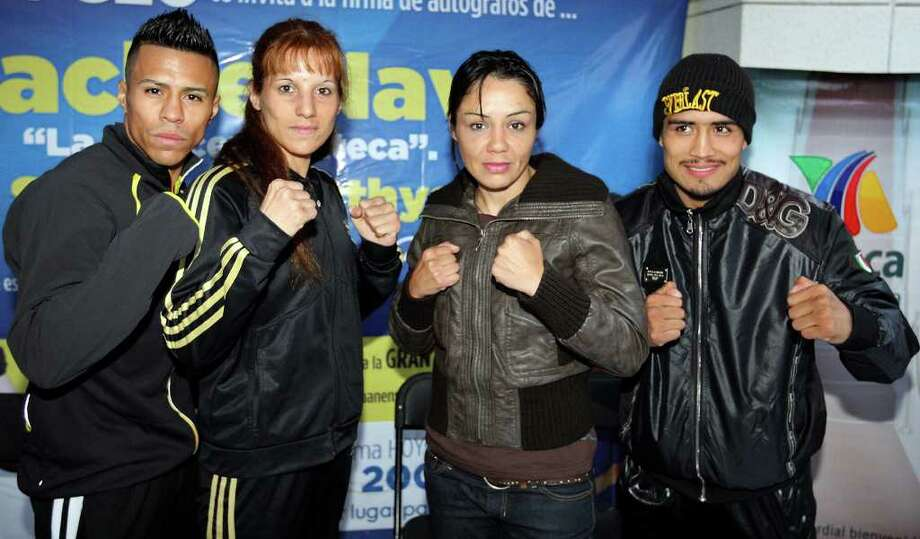 Boxers Raul Martinez (from left), Soledad Mathysse, Jackie Nava, and Rodrigo Guerrero,  pose for photos after signing autographs Wednesday Oct. 5, 2011 in Tijuana, Baja California, Mexico. Martinez and Guerrero will fight for the IBF super flyweight title and Nava will fight Mathysse Saturday Oct. 8 in Tijuana.  (PHOTO BY EDWARD A. ORNELAS/eaornelas@express-news.net) Photo: EDWARD A. ORNELAS, SAN ANTONIO EXPRESS-NEWS / © SAN ANTONIO EXPRESS-NEWS (NFS)
