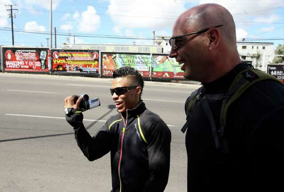 Raul Martinez (left) jokes with conditioning coach Tony Cooper as they walk around Tijuana, Baja California, Mexico Thursday Oct. 6, 2011. Martinez will fight Rodrigo Guerrero for the IBF super flyweight title Saturday Oct. 8 in Tijuana.   (PHOTO BY EDWARD A. ORNELAS/eaornelas@express-news.net) Photo: EDWARD A. ORNELAS, SAN ANTONIO EXPRESS-NEWS / © SAN ANTONIO EXPRESS-NEWS (NFS)