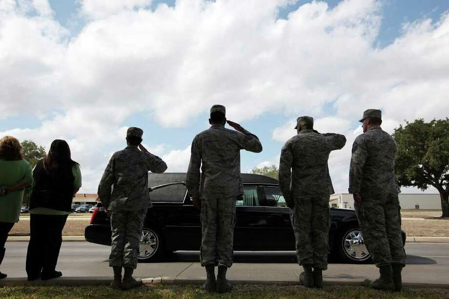 On the eve of today's 10th anniversary of the start of the war in Afghanistan, civilians and military members alike paused to salute Army 1st Lt. Andres Zermeño, whose remains were returned to Randolph AFB on Thursday, Oct. 6, 2011. Zermeño died on Sept. 25 in Afghanistan. Photo: Jerry Lara/glara@express-news.net / SAN ANTONIO EXPRESS-NEWS