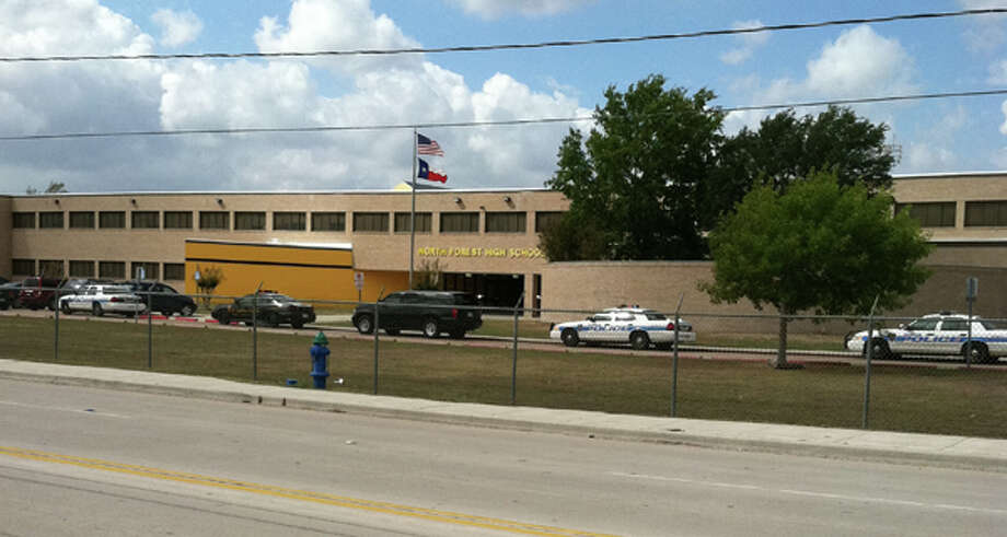 Houston Police cars parked outside North Forest High School Friday afternoon, Oct. 7, 2011. (Dale Lezon / Chronicle)