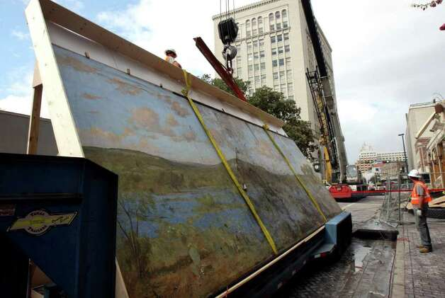 Crews work to load the 30-foot-wide mural of a bluebonnet field by Hill Country artist Porfirio Salinas onto a truck so it can be donated to the Witte Museum. The Wolfson Building that housed the mural was destroyed by fire on Saturday Oct 1, 2011. Photo: HELEN L. MONTOYA, San Antonio Express-News / SAN ANTONIO EXPRESS-NEWS