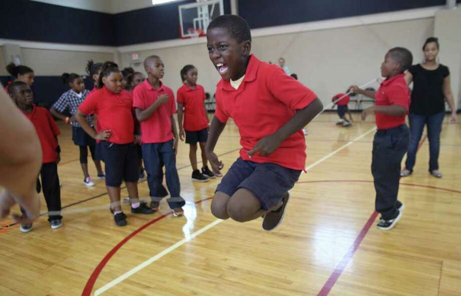Devonte Washington  jumps rope along with 300 other students as Yellowstone Academy hosts the event, Jump Rope for Heart. The event raises money for the American Heart Association which funds heart and stroke research, and provides community and educational programs for youth. Photo: Mayra Beltran, Houston Chronicle / © 2011 Houston Chronicle
