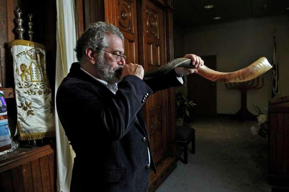 Rabbi Donald Cashman blows the shofar at B'Nai Sholom Reform Congregation for Yom Kippur on Thursday Oct. 6, 2011 in Albany, NY.  ( Philip Kamrass / Times Union) Photo: Philip Kamrass / 00014892A