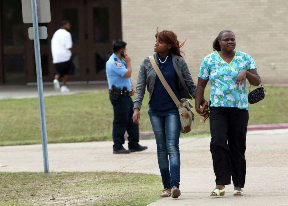North Forest High School student Kendra Thompson, left, walks with her mother, Charlene McGowan, as she leaves the school following a lockdown where there were reports of a student with a gun Friday, Oct. 7, 2011, in Houston. North Forest High School officials lifted a lockdown shortly after noon Friday after finding no student with gun on campus, school officials said. Photo: Brett Coomer, Houston Chronicle / © 2011 Houston Chronicle