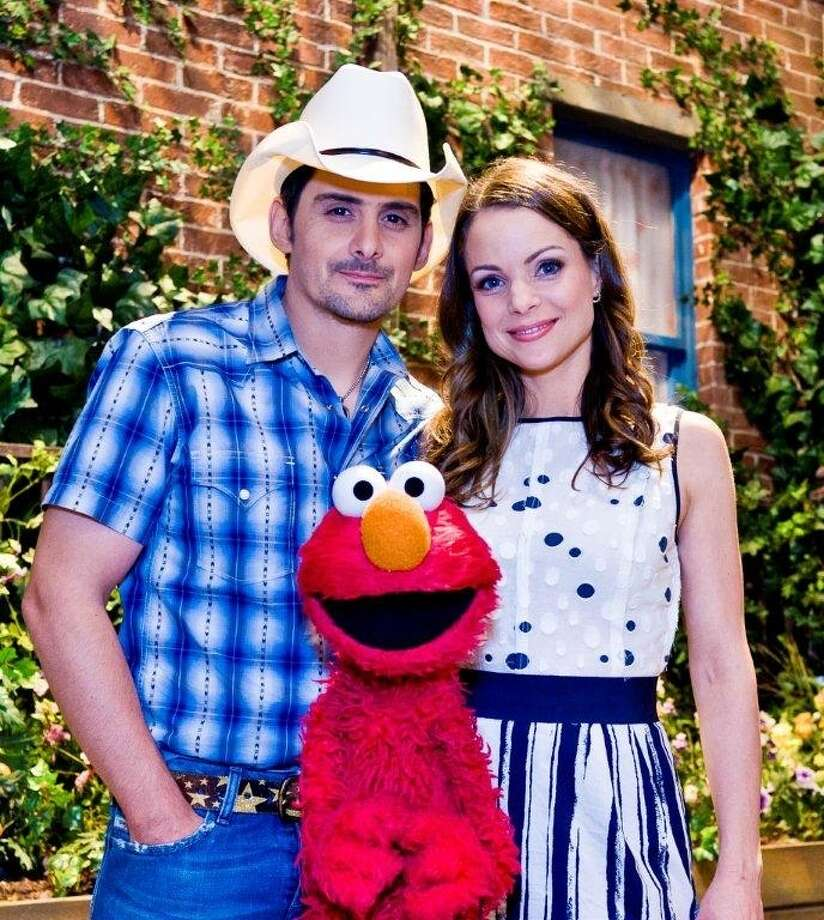 Brad Paisley, Kimberly Williams Paisley and Elmo raise awareness about the widespread issue of hunger in the United States as part of Sesame Street?s primetime television special entitled Growing Hope Against Hunger. 2011 Sesame Workshop. Photo by: Gil Vaknin.