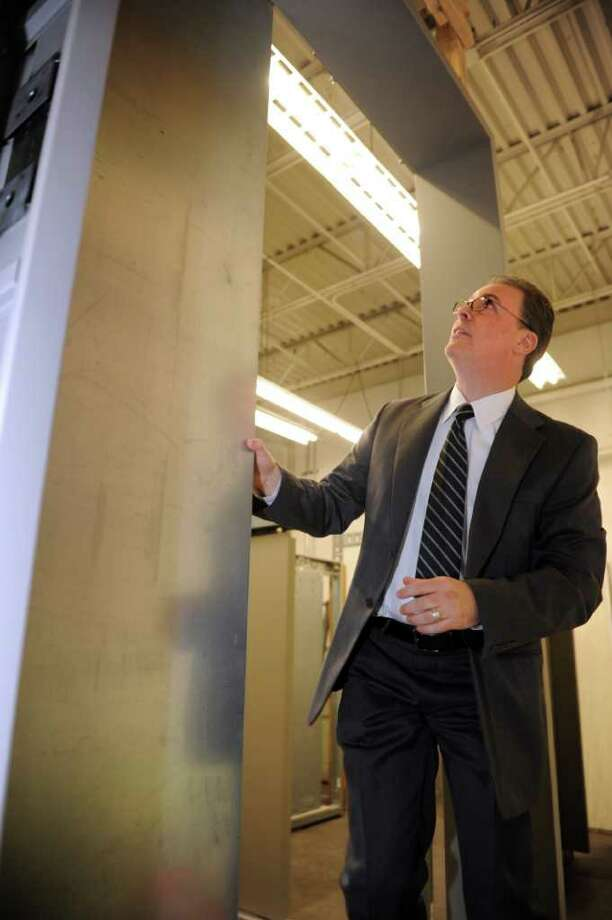 LJ Blaiotta, CEO and president of Columbia Elevator Co., stands next to the elevator doors that the Bridgeport company is manufacturing for the new World Trade Center. Photo: Autumn Driscoll