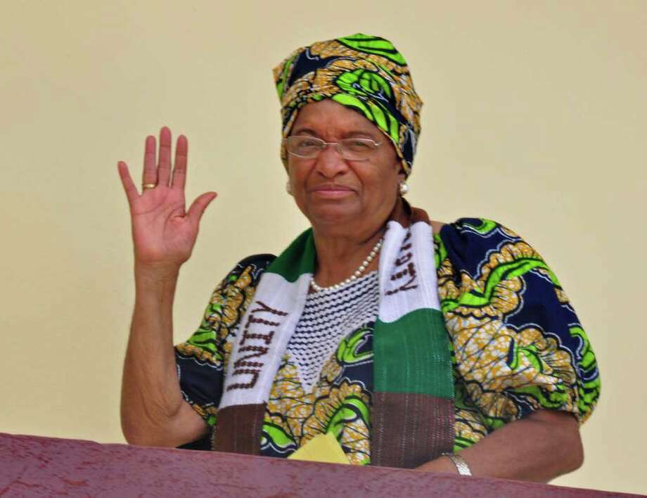 Liberian President Ellen Johnson Sirleaf waves at her home in the city of  Monrovia, Liberia, Friday, Oct 7, 2011. Africa's first democratically elected female president, a Liberian campaigner against rape and a woman who stood up to Yemen's autocratic regime won the Nobel Peace Prize in recognition of the importance of women's rights in the spread of global peace. The 10 million kronor ($1.5 million) award was split three ways between Liberian President Ellen Johnson Sirleaf, women's rights activist Leymah Gbowee from the same African country and democracy activist Tawakkul Karman of Yemen - the first Arab woman to win the prize. (AP/Photo Abbas Dulleh) Photo: Abbas Dulleh / AP