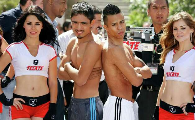 FOR SPORTS - Rodrigo Guerrero (center left) and Raul Martinez pose for the media after the weigh-in held at the Galerias Hipodromo in Tijuana, Baja California, Mexico Friday Oct. 7, 2011. Martinez and Guerrero will fight for the IBF super flyweight title Saturday Oct. 8 in Tijuana.   (PHOTO BY EDWARD A. ORNELAS/eaornelas@express-news.net) Photo: EDWARD A. ORNELAS, SAN ANTONIO EXPRESS-NEWS / © SAN ANTONIO EXPRESS-NEWS (NFS)