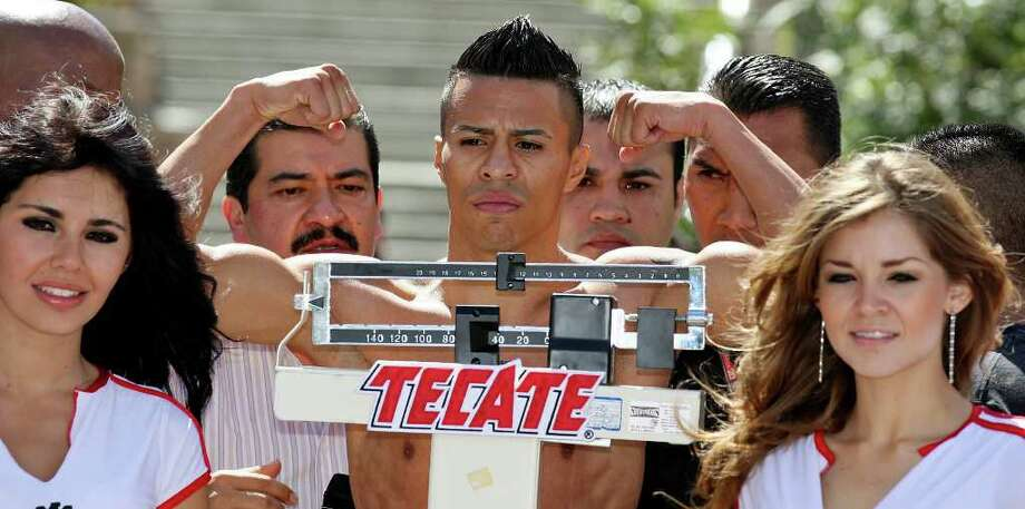 Raul Martinez takes part in the weigh-in held at the Galerias Hipodromo in Tijuana, Baja California, Mexico Friday Oct. 7, 2011. Martinez will fight Rodrigo Guerrero for the IBF super flyweight title Saturday Oct. 8 in Tijuana.   (PHOTO BY EDWARD A. ORNELAS/eaornelas@express-news.net) Photo: EDWARD A. ORNELAS, SAN ANTONIO EXPRESS-NEWS / © SAN ANTONIO EXPRESS-NEWS (NFS)