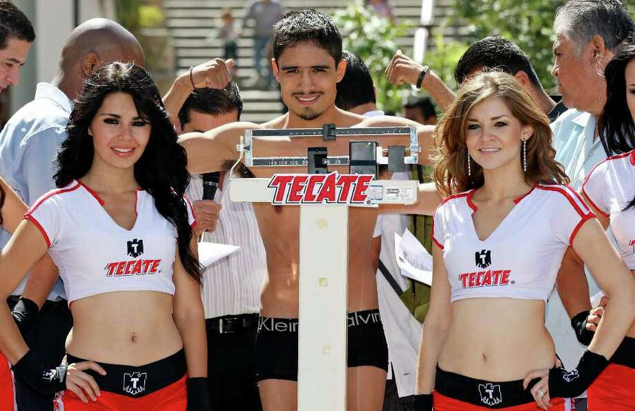 Rodrigo Guerrero takes part in the weigh-in held at the Galerias Hipodromo in Tijuana, Baja California, Mexico Friday Oct. 7, 2011. Guerrero will fight Raul Martinez for the IBF super flyweight title Saturday Oct. 8 in Tijuana.   (PHOTO BY EDWARD A. ORNELAS/eaornelas@express-news.net) Photo: EDWARD A. ORNELAS, SAN ANTONIO EXPRESS-NEWS / © SAN ANTONIO EXPRESS-NEWS (NFS)