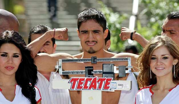 FOR SPORTS - Rodrigo Guerrero takes part in the weigh-in held at the Galerias Hipodromo in Tijuana, Baja California, Mexico Friday Oct. 7, 2011.  Guerrero will fight Raul Martinez  for the IBF super flyweight title Saturday Oct. 8 in Tijuana.   (PHOTO BY EDWARD A. ORNELAS/eaornelas@express-news.net) Photo: EDWARD A. ORNELAS, SAN ANTONIO EXPRESS-NEWS / © SAN ANTONIO EXPRESS-NEWS (NFS)