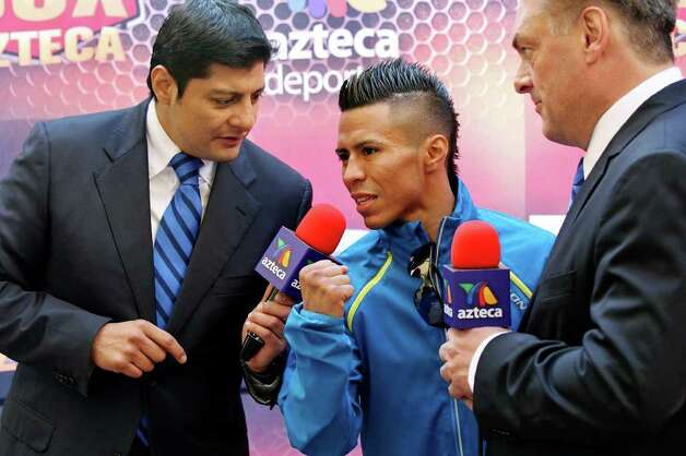 FOR SPORTS - Raul Martinez talks with the media after the weigh-in held at the Galerias Hipodromo in Tijuana, Baja California, Mexico Friday Oct. 7, 2011. Martinez will fight Rodrigo Guerrero for the IBF super flyweight title Saturday Oct. 8 in Tijuana.   (PHOTO BY EDWARD A. ORNELAS/eaornelas@express-news.net) Photo: EDWARD A. ORNELAS, SAN ANTONIO EXPRESS-NEWS / © SAN ANTONIO EXPRESS-NEWS (NFS)