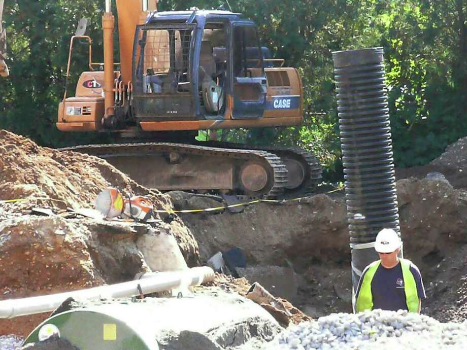 Leaking underground fuel tanks behind Fire Headquarters on Reef Road have driven the project costs $364,969 over budget. Photo: Genevieve Reilly / Fairfield Citizen
