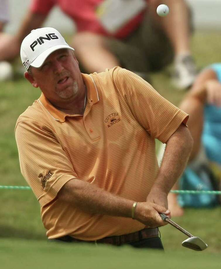 Mark Calcavecchia pitches his third shot onto the No. 9 green during the first round of the Insperity Classic, Friday, October 7, 2011 at the Tournament Course in The Woodlands, TX. Calcavecchia shot a 5-under par 67 good enough for a tie for third with Tom Lehman. Photo: Eric Christian Smith, For The Chronicle