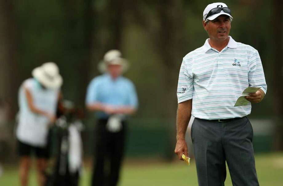 Defending champion Fred Couples (right) checks his yardage from the No. 1 fairway before his second shot during the first round of the Insperity Classic, Friday, October 7, 2011 at the Tournament Course in The Woodlands, TX. Photo: Eric Christian Smith, For The Chronicle