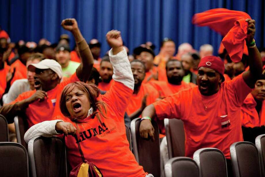 Vanessa Hamilton and other members of the Laborers' International Union of North America cheer a speaker who proclaims the pipeline would provide jobs. Photo: Andrew Harrer, Bloomberg / © 2011 Bloomberg Finance LP