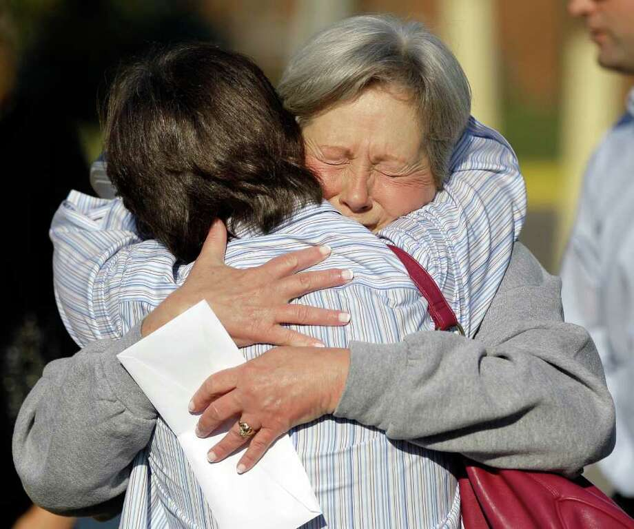 MARK HUMPHREY: ASSOCIATED PRESS THIS: Gaile Owens, 58, right, hugs her friend Linda Oakley after Owens was released from the Tennessee Prison for Women on Friday in Nashville, Tenn. Owens spent 26 years on death row for hiring a stranger to kill her husband. Photo: Mark Humphrey / AP