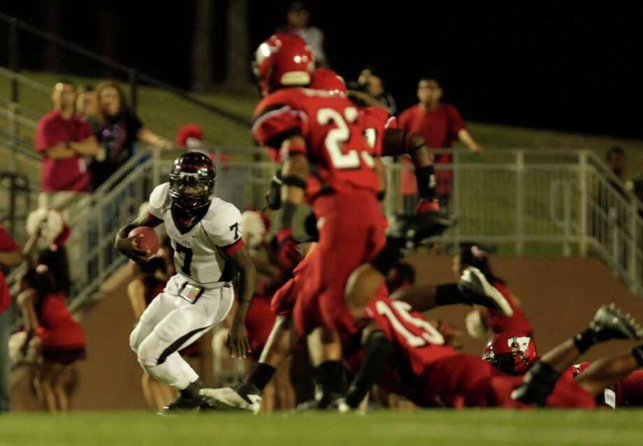 Port Arthur's Terrence Singleton escapes from a group of North Shore defenders in the first quarter as North Shore High School played Port Arthur Memorial High School at Galena Park ISD District Athletic Complex Friday, Oct. 7, 2011, in Houston. Photo: Johnny Hanson, Houston Chronicle / © 2011 Houston Chronicle